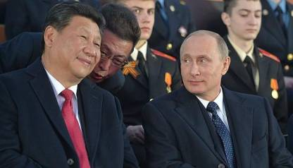 The parade through Red Square was watched by Vladimir Putin, right, and Xi Jinping.